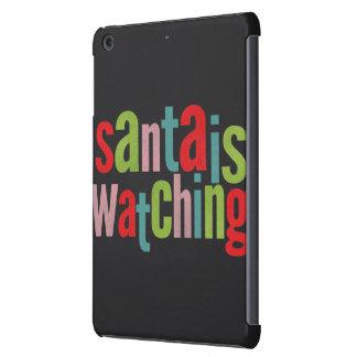 Santa está mirando la pizarra colorida fundas de iPad mini
