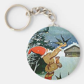 Santa feeding birds by hand in Christmas snow key Keychains