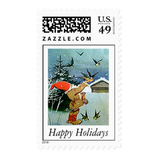 Santa feeding birds by hand in snow stamps