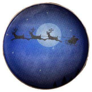 santa flying sleigh across blue night sky chocolate dipped oreo