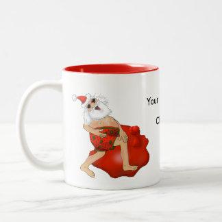 Santa frolicking in swimming trunks. Two-Tone coffee mug