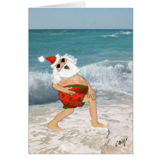 Santa frolicking on the beach in swimming trunks. card