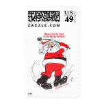Santa golfing Christmas gifts. Postage Stamps