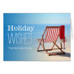 Santa hat on a deck chair. Christmas at the Card