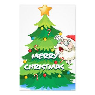 Santa hiding at the back of the christmas tree stationery