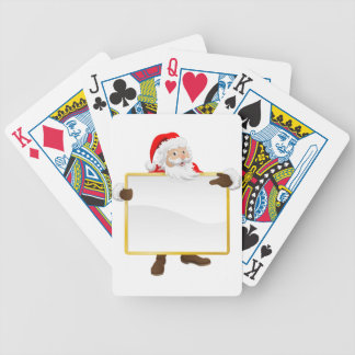 Santa holding Christmas sign and pointing Bicycle Poker Cards