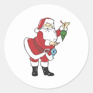 Santa holding decorations sticker