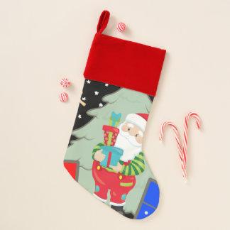 santa holding presents christmas stocking