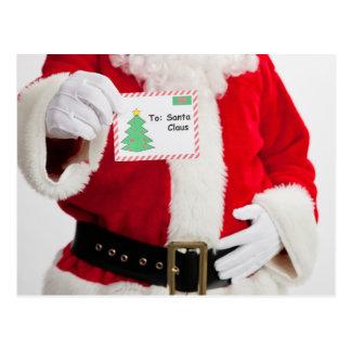 Santa holding up card