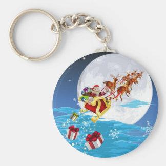 Santa in his sled key chain