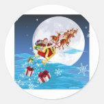 Santa in his sled sticker