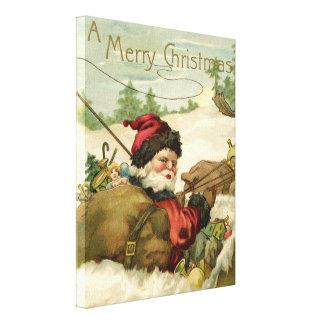 Santa in his Sleigh Canvas Print