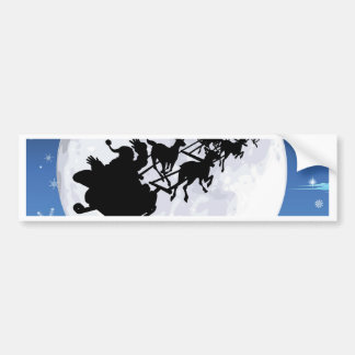 Santa in sled silhouette against full moon bumper stickers