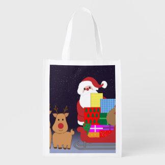 Santa lindo con el reno bolsas para la compra