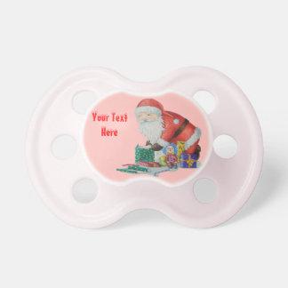 Santa lindo y juguetes que envuelven los regalos chupete