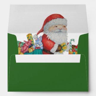 Santa lindo y sobre verde del navidad de los jugue