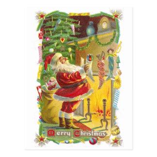 Santa, medias y navidad del vintage de las tarjeta postal