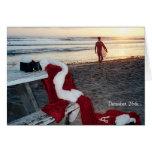 Santa practica surf el día después del navidad felicitacion