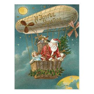 Santa presenta el globo del árbol de navidad de postal