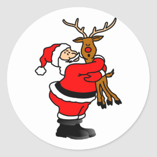 Santa que abraza el reno pegatina redonda