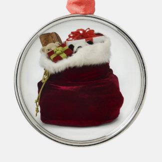 Santa que descarga los regalos por el árbol adorno navideño redondo de metal