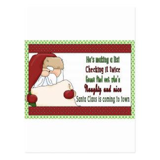 Santa que hace navidad de una lista tarjetas postales