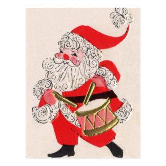 Santa que juega un tambor postal