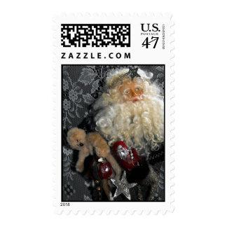Santa que lleva a cabo franqueo de los juguetes estampillas