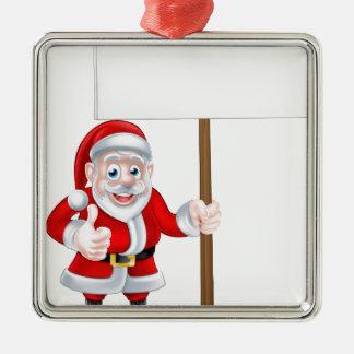 Santa que lleva a cabo la muestra adorno navideño cuadrado de metal