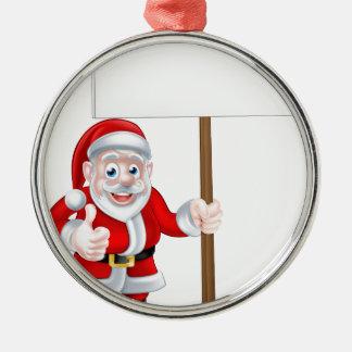 Santa que lleva a cabo la muestra adorno navideño redondo de metal