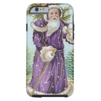 Santa que lleva un árbol de navidad