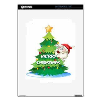Santa que oculta en la parte posterior del árbol iPad 2 skins