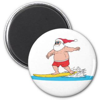 Santa que practica surf imán para frigorífico