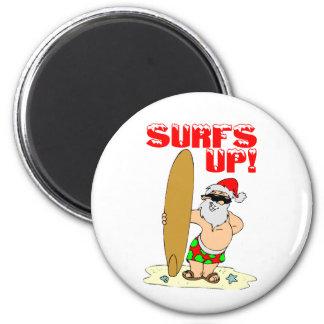 Santa que practica surf imán redondo 5 cm