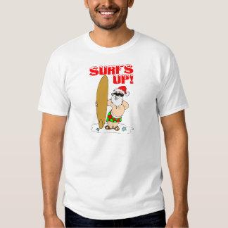 Santa que practica surf remeras
