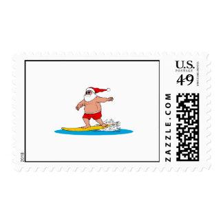 Santa que practica surf sellos