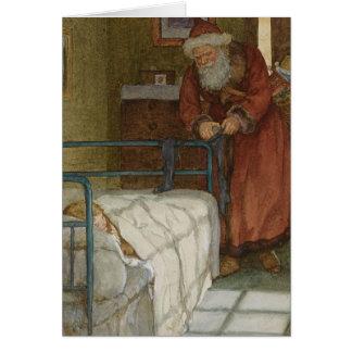 Santa que rellena medias tarjeta de felicitación