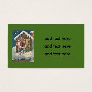 Santa que sale del árbol de navidad de la casa tarjeta de negocios