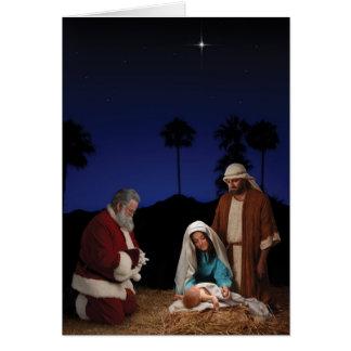 Santa que se arrodilla en la natividad felicitacion