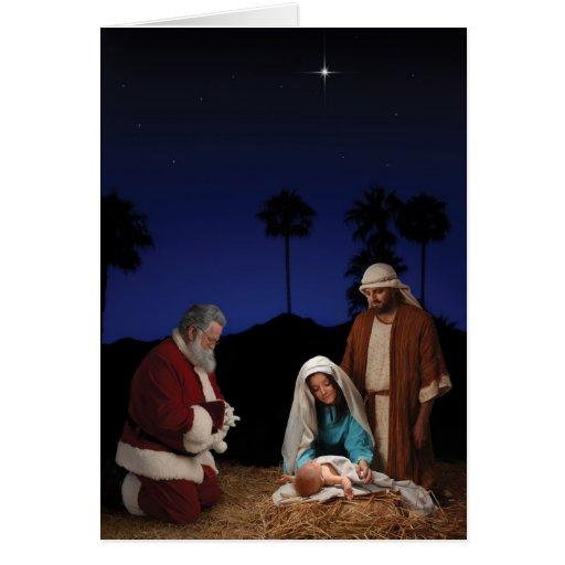 Santa que se arrodilla en la natividad tarjeta de felicitación