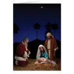 Santa que se arrodilla en la natividad tarjetón