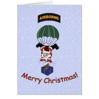 Santa que se lanza en paracaídas tarjeta de felicitación