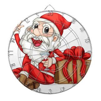 Santa que se sienta al lado de un regalo