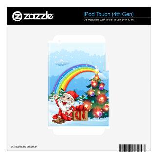 Santa que se sienta al lado del regalo cerca del iPod touch 4G skins
