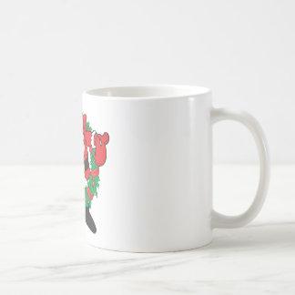 Santa que sorbe taza de café