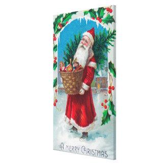 Santa que sostiene la cesta de escena de los jugue impresiones de lienzo