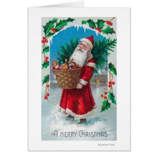 Santa que sostiene la cesta de escena de los jugue felicitaciones