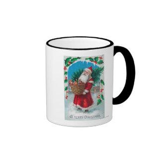 Santa que sostiene la cesta de escena de los jugue taza de café