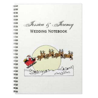 Santa Reindeer Over Snow Covered Town Lt Moon Notebook