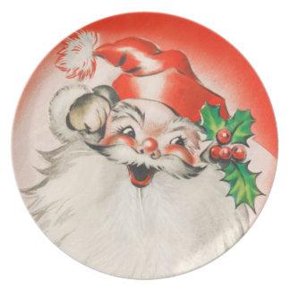 Santa retro embroma la placa platos de comidas